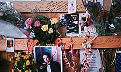 Detail of Flowers and Pictures left by family.